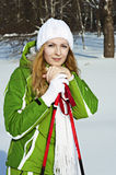 Woman skier in snowy forest with ski poles Royalty Free Stock Photography