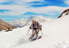 Woman skier in the soft snow. Royalty Free Stock Image
