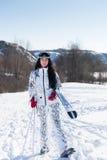 Woman Skier Standing at Snow Looking at Camera Stock Image
