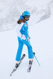 Woman skier in suit turns in winter Royalty Free Stock Photography