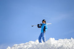 Woman skier on top of the mountain. Winter sports concept Stock Photo