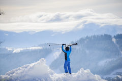 Woman skier on top of the mountain. Winter sports concept Stock Image