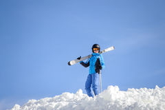 Woman skier on top of the mountain. Winter sports concept Royalty Free Stock Image
