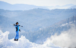 Woman skier on top of the mountain. Winter sports concept Stock Photography