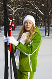 Woman skier in winter forest Stock Photos