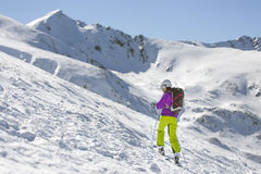 Woman skier. Taking a break on a sunny winter day Stock Photography