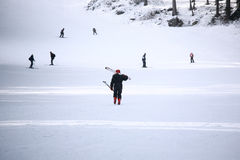 Woman skiing. Woman carrying skis on shoulder Stock Photography