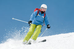 Woman skiing. Mid adult woman skiing downhill Royalty Free Stock Photo