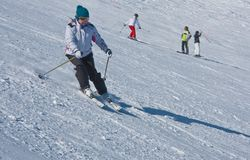 A woman is skiing Royalty Free Stock Photo