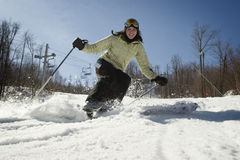 Woman skiing by really close to camera Stock Photography