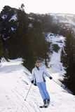 Woman Skiing Down Slope Royalty Free Stock Photography