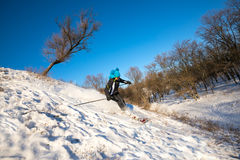 Woman skiing downhill on background of blue sky Royalty Free Stock Images