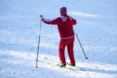 Woman skiing in the park in the afternoon close-up . stock image