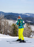 Woman skiing showing thumbs up Stock Images