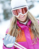 Woman skiing with ski googles in winter royalty free stock photography