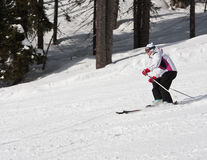 Woman is skiing at a ski resort Royalty Free Stock Photo