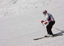 Woman is skiing at a ski resort. The Ski resort Madonna di Campiglio. Italy Royalty Free Stock Photography