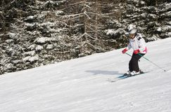 Woman is skiing at a ski resort Stock Images