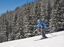 Woman is skiing at a ski resort Royalty Free Stock Image