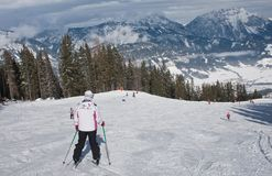A woman is skiing at a ski resort Stock Images