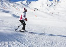 The woman is skiing at a ski resort Royalty Free Stock Photos