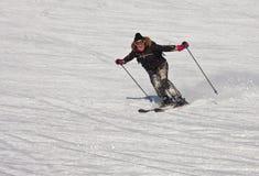 Woman is skiing at a ski resort Stock Image