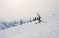 A woman is skiing at a ski resort. Austr royalty free stock images