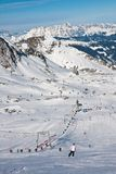 A woman is skiing at a ski resort of Kaprun, Kitzsteinhorn glaci Royalty Free Stock Photo