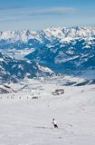 A woman is skiing at a ski resort of Kaprun, Kitzsteinhorn glaci Royalty Free Stock Image