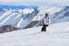 A woman is skiing at a ski resort Stock Image
