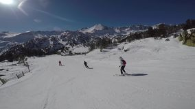 A woman skiing on a ski track, the sun and snowy mountains. stock video