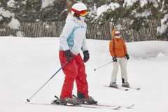 Woman skiing under the snow. Winter sport. Ski slope royalty free stock image