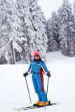 Woman skiing on winter vacations Stock Photos