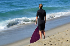 Woman skim boarder waiting fora shore break wave to ride at Aliso Beach in Laguna Beach, California. Stock Images