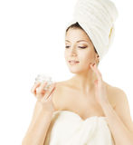 Woman Skin Care, model applying cream on white Royalty Free Stock Image
