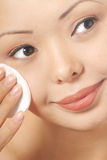 Woman and skin cleaner Royalty Free Stock Image