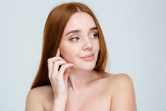 Woman with skincare looking away Stock Images