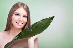 Woman skincare with plant Stock Images