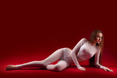 Woman in a skintight suit her figure Royalty Free Stock Images