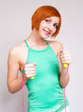 Woman with a skipping rope Royalty Free Stock Photos