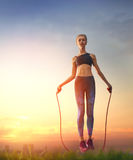 Woman with skipping rope. royalty free stock photography