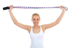 Woman with skipping rope  over white Royalty Free Stock Images