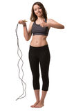 A woman with the skipping-rope showing a hand sign good. Royalty Free Stock Photos
