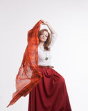 Woman in skirt dancing with a red handkerchief Stock Photos