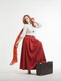 Woman in skirt dancing with a red handkerchief Stock Photo