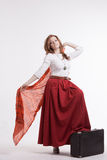 Woman in skirt dancing with a red handkerchief Stock Images