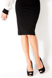 Woman in skirt. Woman in elegant tight black skirt and high heel shoes Stock Image
