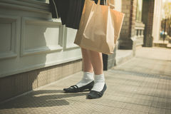 Woman in skirt walking the street Stock Photography