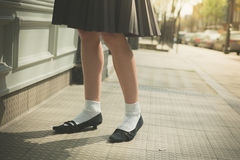 Woman in skirt walking the street Stock Photos