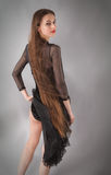 Woman in Skirted Leotard With Long Blowing Hair royalty free stock photo
